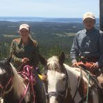 Posing on Horseback in Front of Beautiful View in Yellowstone
